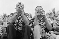Flower Power, 1953 by Orlando/Three Lions/Getty via time.com  Tourists await the arrival of the Hula dancers on Honolulu's Waikiki Beach in 1953. #Hawaiian_Shirt #Alfred_Shaheen #time_com #Orlando_Three_Lions_Getty