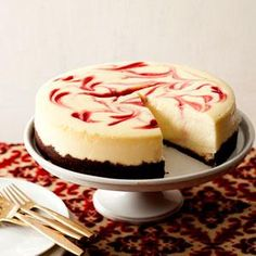 Savor all the rich flavor of cheesecake but with less fat and calories as in this lightened verson of Raspberry Swirl Cheesecake.