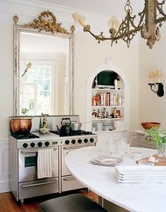 mirror idea over the stove, antique light fixture