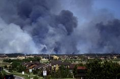 Large plumes of smoke rise from a wild land fire in the Black Forest northeast of Colorado Springs, Colo. on Tuesday, June 11, 2013.  Homes have already burned and the wind is expected to continue through the afternoon. (Photo by Aaron Ontiveroz/AP Photo/The Denver Post) http://avaxnews.me/fact/Colorado_Fires_Growing.html