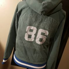 🌹🌹Cute Vintage  Pink University hoodie This is a cute Victoria Secret Pink University hoodie, says 86 on the front, 86 and love pink University on the back trim in blue and white Letterman's jacket sweater trimming.  Has been worn several times but is in excellent condition with the perfect wear.  Wrinkles are not extra.....lol my goodness how embarrassing. PINK Victoria's Secret Tops Sweatshirts & Hoodies