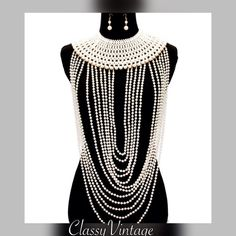 Talk about a statement necklace If you love layers of faux pearls and don't mind being the center of attention this beauty is for you! If you want a bit of WOW FACTOR- this stunning set will do it. CORE' Jewelry Necklaces
