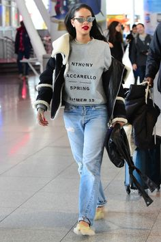 Who: Rihanna What: Major Accessories on a Casual Look Why: The pop star took to the airport in an expected combo of a sweatshirt and boyfriend jeans, but made her accessories the star of the show in furry heels, a Chanel bag that looks like a little black jacket, Adam Selman x Le Specs sunnies and a gold choker necklace. Get the look now: Adam Selman x Le Specs sunglasses, $120, openingceremony.us.
