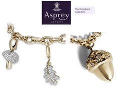 Kate was wearing charms by Asprey of London, from the jeweler's Woodland collection.