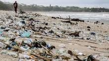 The sight of trash washed up on Kuta Beach has become an annual phenomenon as piles of debris are carried to the beach by strong currents during the winter months. (Agung Parameswara/Getty Images)