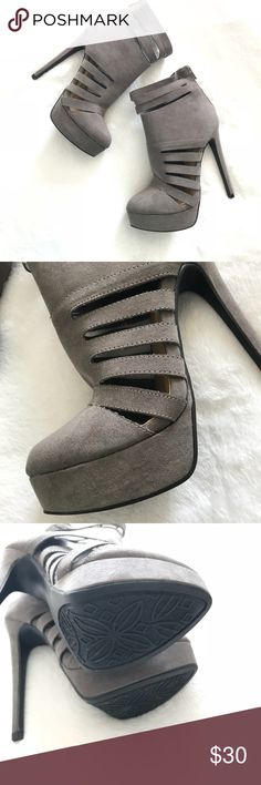 Sexy Caged Platform Bootie {NWOT} Strapped and so sexy-bold platform bootie with a triple ankle strap and strappy side cutout detailing. Zip back, 5 1/2 inch heel and 1 inch platform. New without box. Grey color. Purchased with every intention of wearing, but just moved and still haven't worn them. They deserve who shows them off! Brand new, no box. JustFab Shoes Ankle Boots & Booties