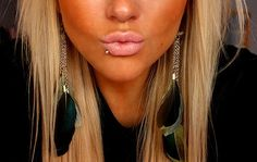 love the hair, the tan, and the piercing.