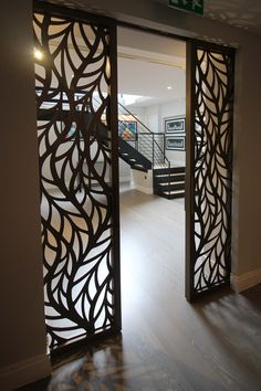 Silian art gallery, London. Laser cut sliding doors. Frond design by Miles and Lincoln. www.milesandlincoln.com