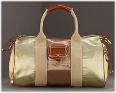 Marc Jacobs Bauletto Satin Bag. I'm on the hunt for this one to add to my collection :)