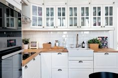 One of the brightest, loveliest classic style kitchens. Made with IKEA BODBYN off white, DOMSJÖ sink, RINGSKÄR tap, and a beautiful white subway tile
