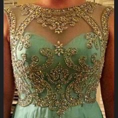"""Stunning Formal Gown. This designer gown, by Jovani, is a Vintage Inspired floor length. Prom dress/ball gown in turquoise with heavy beaded detail bodice with flowing long skirt and slight train. WORN ONCE!                                                                 I'm 5'4... Wore this with 3"""" heels, about a cm above ground with heels ON. Jovani Dresses"""