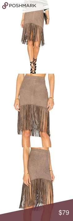 bishop + young Suede Fringe Skirt in Taupe Suede textured fabric. Fully lined. Fringe hem.Hidden side zipper closure. Poly blend. Dry clean. bishop  + young  Skirts
