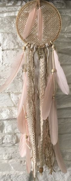 A personal favorite from my Etsy shop https://www.etsy.com/listing/471035183/blush-pink-boho-dream-catcher-bohemian