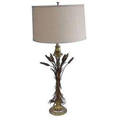 "This is a lovely Mid-Century 1960's wood and metal wheat bunch table lamp with a gilt finish. One light; wired in working condition. The silk shade included: 17"" diameter x 11"" h. Wear is consistent with age and use."