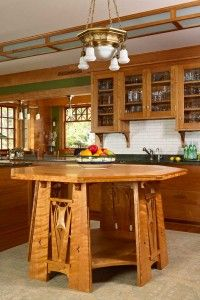 The custom octagonal buffet table is inset with a cork top for serving hot dishes.