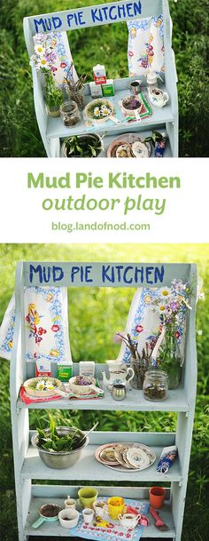 Mud pies and flowers sit on the counter of a kids mud pie kitchen