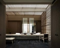 A spa interior in Bali. I like the use of filtered skylights and the idea of that chair near the sinks.
