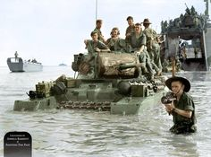 Matilda MK.II tank of the 2/9th Armoured Regiment with Australian soldiers in landing on Green beach (now Muara Beach) the island of Labuan, Borneo. 10th June 1945.