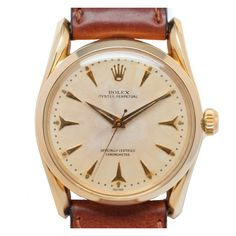 "14K GOLD ROLEX REFERENCE 6590 WITH ""SHARK'S TEETH"" DIAL, CIRCA 1960"