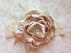 Gorgeous beige satin, with ivory feathers, lace, and pearl accents, and a touch of diamonds! Very gorgeous and elegant! Newborn to adult sizes