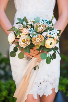 Fabulous paper flower bouquet: http://www.stylemepretty.com/little-black-book-blog/2015/05/22/romantic-garden-bridal-shower-inspiration/   Photography: Kim Le - http://www.kimlephotography.com/