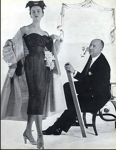 1951 - Christian Dior with model Sylvie Hirsch wearing acocktail ensemble,