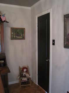 """take a plain white door, add the 1/4"""" trim and paint it black"""