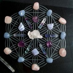 Great use for the Flower of Life and Sacred Geometry in a crystal grid!  I think I will use this as a pattern and see what I can come up with! :)