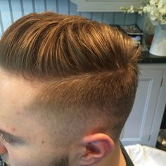 Short fade into a textured top using beadhead for men by Tigi