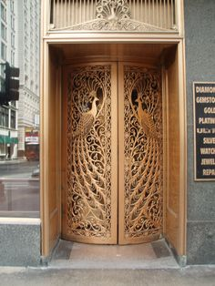 Door to the former C. Peacock jewelry store on State Street at Monroe in Downtown Chicago, Illinois. Main Door Design, Wooden Doors, Building A House, House Styles, House Main Door, Entry Doors, Wood Doors Interior, Gate Design, Art Deco Architecture
