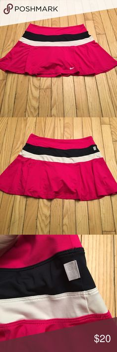 Womens Dri-fit Nike Tennis Skirt, hot pink, M Eye catching hot pink dri-fit tennis skirt. With a white and navy blue stripe. Excellent condition. Nike Skirts Mini