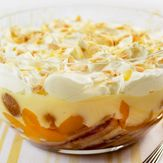 Old English Trifle recipe from Mary Berry's Complete Cookbook. English trifle is never made with jelly: just fruit ( this recipe uses tinned but I always use fresh),alcohol soaked sponge,homemade custard and cream as a topping with nuts sprinkled over.