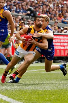 2015 Toyota AFL Grand Final - Hawthorn v West Coast - Brad Sheppard of the Eagles tackles Paul Puopolo of the Hawks during the 2015 Toyota AFL Grand Final match between the Hawthorn Hawks and the West Coast Eagles at the Melbourne Cricket Ground, Melbourne, Australia on October 3, 2015. West Coast Eagles, Pro Cycling, World Of Sports, Melbourne Australia, Hawks, Rugby, Cricket, Finals, Toyota