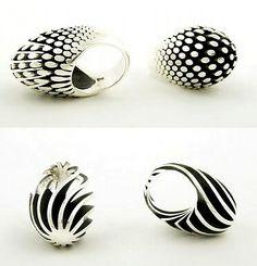 """Egg"" series rings by Sarah Herriot. Sterling silver."