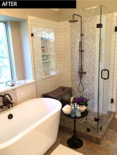 Master bath reno... Glass shower ...vertical stripe of accent tile