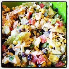 Chicken Taco salad thats HEALTHY! Theres black beans, corn, green peppers, tomatoes, cilantro, green onions, chicken, avocado  tortilla chips. All tossed together with a taco ranch dressing made with Greek yogurt. ... DELISH!!!!