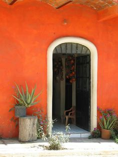 Love the orange wall of this adobe home