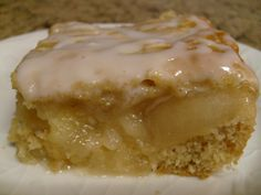 Apple Filled Coffee Cake    1 pkg. (2-layer size) white cake mix  1 tsp.  ground cinnamon  1 cup sour Cream  3   eggs  1/4 cup water  1 can  (21 oz.) apple  pie filling  1 cup  powdered sugar  1-1/2 Tbsp. milk  Directions:    1. Heat oven to 350ºF. Beat first 5 ingredients with mixer until well blended. Pour into greased and floured 13×9-inch pan
