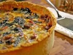Laura's deep-dish tart is a heartier version of a French brunch classic: the quiche. She swaps in-season Swiss chard for spinach, then adds raisins and pine nuts for sweetness and crunch.