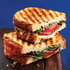 Grilled Italian Panini - INGREDIENTS: 2 slices whole-grain Italian bread, 2 tsp prepared pesto, 1 1/2 oz part-skim mozzarella cheese, sliced, 1 plum tomato, sliced, 2 large basil leaves. Place bread on a work surface and spread 1 tsp pesto on each slice. On 1 slice, layer cheese, tomato and basil. Top with remaining slice of bread, pesto side down. Place sandwich in a hot panini press and grill until bread toasts and cheese softens, about 4 minutes.