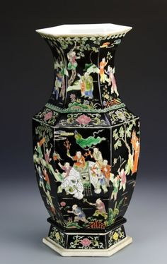 China, Kangxi Period, Famille Noir vase, in a six-sided form, decorated all over in a colorful scene of figures celebrating, Kangxi mark on base. Height 16 1/2 in.