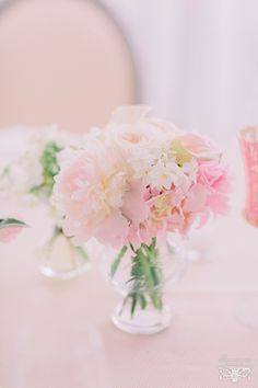 The centerpieces will be trios of mason jars in varying heights wrapped in lace filled with cream hydrangeas, blush pink roses and lavender ranunculus surrounded by silver mercury glass votives.