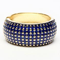 Gold-tone brass enamel cuff with studs.