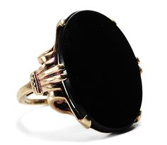 """Onyx Ring: 20th century, onyx in 14k rose gold mount. """"What was old is once again new…onyx was a popular gemstone when Victoria was Queen as well as during the Jazz Age and now the black stone is hitting the top of the 21st century jewelry charts."""""""
