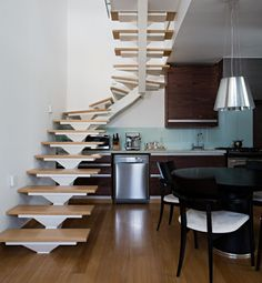 Small space with kitchen under stairs