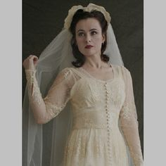 1940s wedding dress with lovely buttons and lace.