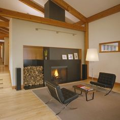 Fire place with a place for logs. post and beam wood open ceilings