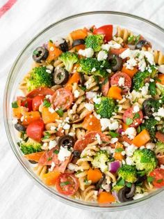 This Pizza Pasta Salad is the PERFECT pasta salad recipe. A fresh twist on classic Italian pasta salad made with real, simple ingredients. Loaded with meat, cheese, and crunchy veggies, everyone loves it and there are never any leftovers! @wellplated
