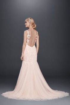 It can\'t get more romantic than this trumpet gown with a gorgeous beaded venice lace bodice, scalloped lace tank sleeves, v-neckline and an alluring button back detail. All wrapped up into one alluri