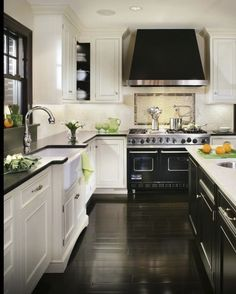 A stylish black and white kitchen plays up high contrast. Love it !!! This is what I want! Love the floor too!!!!!!